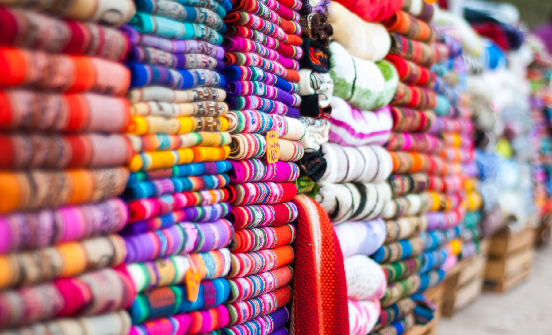 Brightly colored fabrics on shelves