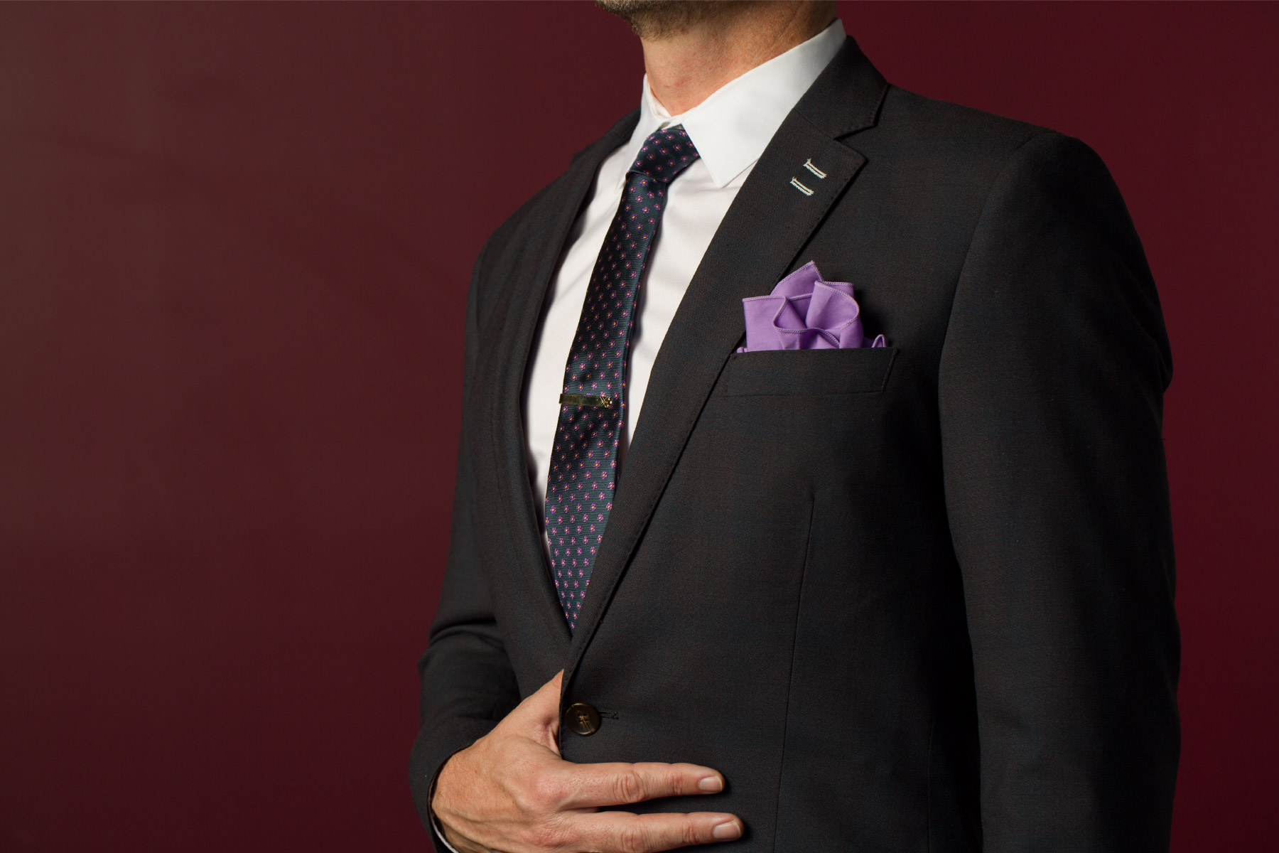 Client's custom made suit with lavender accessories