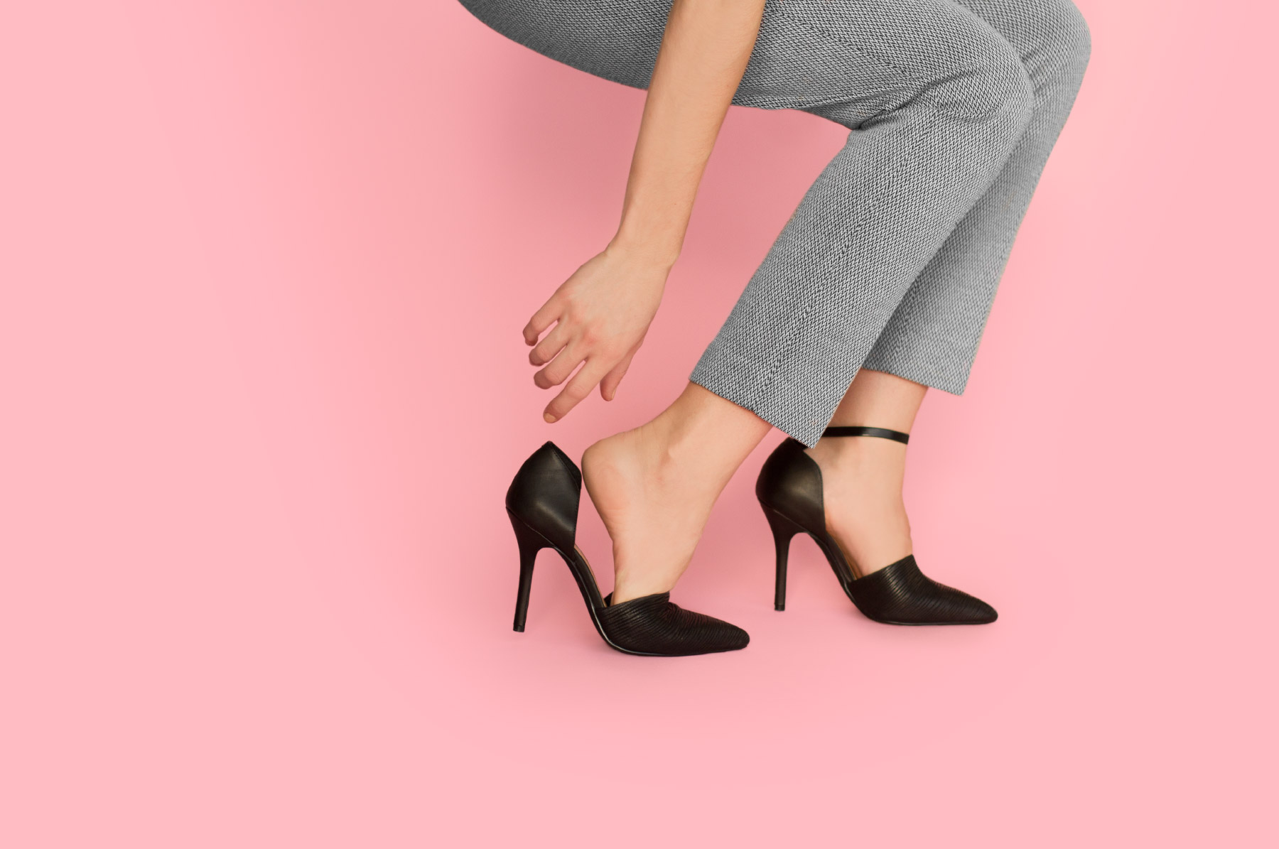 Business woman wearing attachable ankle straps
