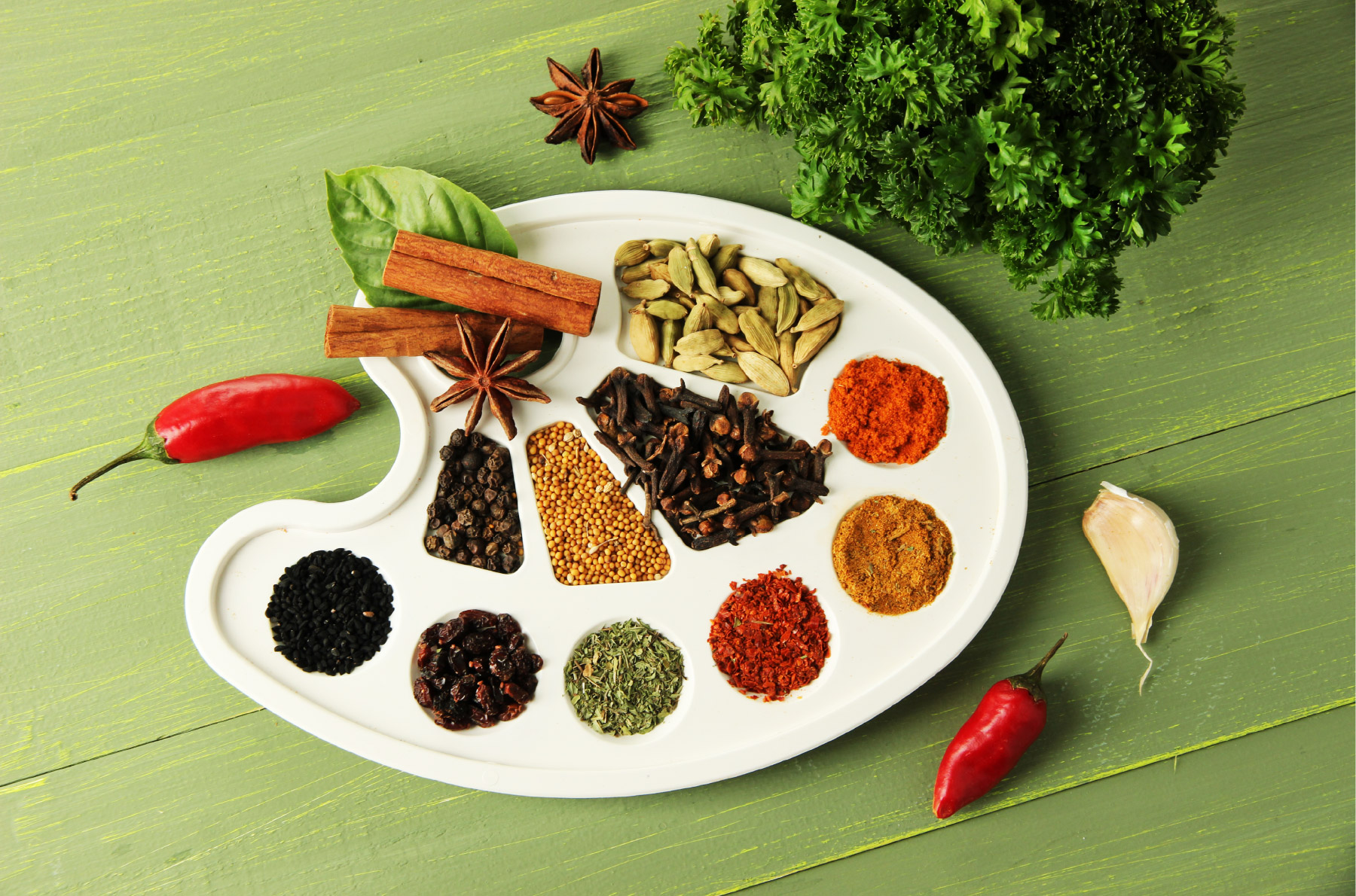 Variety of spices on a painters palette