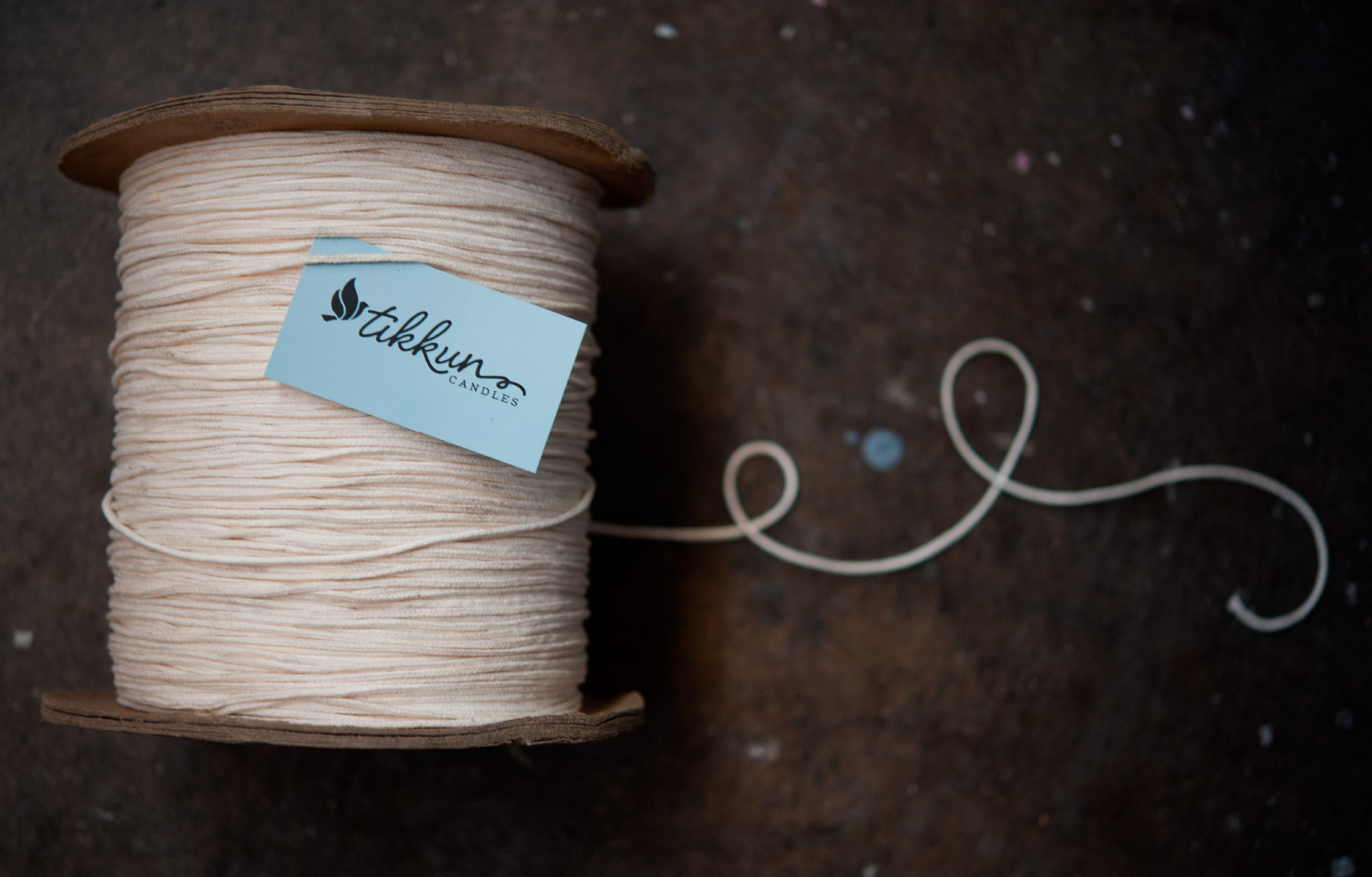Business card on spool of thread